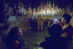 Underground River and Cave (aaronrhawkins) Tags: cenote mexico tulum riviera maya cancun yucatan peninsula carribbean cave stalactite underground river water dark family tour guide jorge jessica joshua flashlight illuminate enclosed ceiling silhouette shadow aaronhawkins