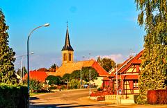 L'église Saint-Matthieu à Chavannes-sur-l'Étang... (MickyFlick) Tags: church spire village road streetlamps signs chavannessurlétang hautrhin alsace france europe mickyflick