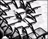 The metal chair boogie (Bob R.L. Evans) Tags: chairs unusual abstract surreal graytones blackandwhite defamiliarization metal symmetry confusion