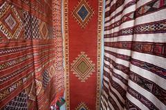 in the carpet shop (diminoc) Tags: carpets rugs morroco marrakech emporium bazaar souk woven colours patterns textures abstract
