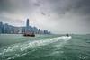 Away (Zoom In, Click On, Check Out) Tags: hong kong hongkong harbour water island tower boat boats junk lights day night rain gloom gloomy