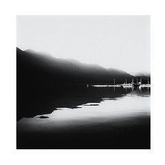 Pitt Lake (Tracy Linnel.) Tags: pittlake vancouver lake blackandwhite atmosphere landscape mountains pier dock water shadow reflection skancheli