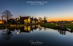 Merry Christmas and a happy new year! (Henk Verheyen) Tags: nl nederland netherlands zaanseschans zaanstad buiten landscape landschap lente molen outdoor spring windmill windmolen water blue hour blauwe uur