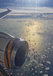 Airbus A319 wing and engine of Tiger Airways (Scoot) over the Gulf of Thailand en route from Singapore to Bangkok