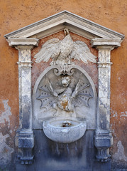 Bird and dragon sculptures above a fountain - Piazza of St. Peter's Basilica, Rome (Monceau) Tags: vatican rome stpetersbasilica outdoors fountain bird dragon relief sculptures