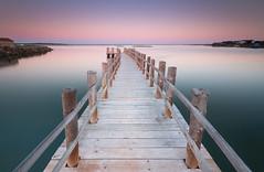 Moinho de Maré sunset (Aljaž Vidmar   ADesign Studio) Tags: wood tranquility landscape calm pier logs sea longexposure filters nisifilters sunset muted setubal seascape nature swamp portugal