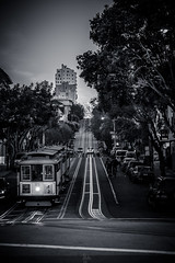 The Hills of San Francisco (Rohit KC Photography) Tags: sanfrancisco uphill hills roads street lines blackandwhite bw edited california vignette cablecar shadow dark greyscale canon canon5dmarkii canonef24105mmf4l road tree train traffic
