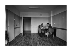 The card game (Jan Dobrovsky) Tags: cardgame monochrome biogon21mm child psychiatricclinic blackandwhite human people room leicam10 reallife humanity social document indoor children kids pastime space distress hopelessness
