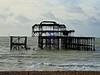 Balancing Act (bimbler2009) Tags: olympustg4 sky cloud sea ocean water pier architecture derelect brighton westpierremains beach sail boat