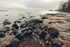 Lauttasaari (Bunaro) Tags: lauttasaari helsinki suomi finland europe winter sunset sea cloudy overcast cliff beach stones water seascape landscape long exposure