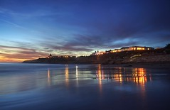 Blue as in wonder, not melancholy (PeterThoeny) Tags: naturalbridgesstatebeach santacruz california sanfranciscobay sanfranciscobayarea building light ocean pacific pacificocean water sunset cloud cloudy reflection waterreflection blue orange gold golden bluehour night dusk sky sony sonya7 a7 a7ii a7mii alpha7mii ilce7m2 fe2870mmf3556oss 1xp raw photomatix hdr qualityhdr qualityhdrphotography sea longexposure ndfilter fav200 fullframe blur