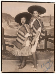 Vintage 1965 Souvenir Photo : The Hopeless Romantic : Mrs. Juan Escobar (CHAIN12) Tags: vintage photo scan scanned souvenir sombrero serape mexican latinas mexicanas fence chachit poncho paintedbackdrop kthyphts31965mrsjuanescobar