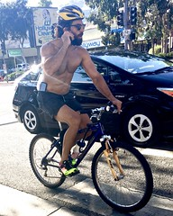 IMG_7448 (danimaniacs) Tags: hot sexy man guy cellphone shirtless bike bicycle beard scruff cap helmet westhollywood shorts