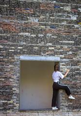 untitled (Robert Borden) Tags: woman photoshoot candid person people stone wall hangzhou china asia chinaacademyofart caa canon canonrebel goofy fun silly