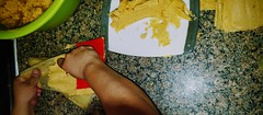 prep food 2 (boxerrod) Tags: famliy tradition temales hispanic wife love pork cooking food kitchen potspans houston smartphone samsung lookingdown wine maze cornhusk recipe hands arms overhead photography white plate redwine