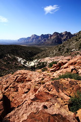 Red Rock Canyon Vista (steveboer.com) Tags: redrockcanyon nevada lasvegas mountain rock valley canyon desert nature landscape sky soil wilderness outdoors rocky hill geology noperson travel outdoor mountainouslandforms badlands ridge nationalpark cloud hillside ground scenic shrubland top background flora arid side sandstone terrain overlooking plant summer dry formation view scenery adventure large red dirt highland covered