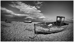 Three Boats (rossifanmark) Tags: dungeness boats seaside seascape mono monochrome pebbles beach clouds fishing derelict old decaying decay weathered petina