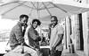Chilling out in Porto (Marian Pollock) Tags: portugal downtown urban people boys umbrella balcony trio porto