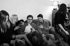 Christmas party (Gary Kinsman) Tags: flash candid unposed fujix100t fujifilmx100t london 2017 nw5 kentishtown party houseparty blackwhite bw night livingroom christmas christmasparty crosseyed sofa talk talking people person phone show