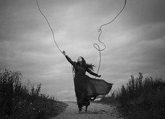 Beyond My Control (Maren Klemp) Tags: fineartphotography fineartphotographer darkart darkartphotography blackandwhite monochrome woman portrait selfportrait conceptual rope painterly dreamy clouds running surreal vintage ethereal nature outdoors path