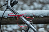 Red Ribbon (suzanne~) Tags: bike bicycle redribbon awareness snow outdoor munich germany project handlebar symbol solidarity 100bicycles