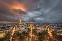 Dramatic View of Paris (Jacob Surland) Tags: arch archoftriumph architecture art building capital caughtinpixels champsdeelysee city citybynight citylife cityscape clouds country eiffeltower elevatedview fineart fineartphotography france geometry hdr highdynamicrange highrise highangleview historic house jacobsurland light lightning lightningbolt lights lines night oldhouse oldbuilding paris realismdigitalart sprawling storm stormy sunsettoureiffel thunder time toureiffel tower trafic travel traveldestination travelandtourism tree trees triomphedearc triumfbuen urban warmlight weather worklife