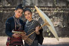 Larnoy and Tata in the shade (jonasfj) Tags: portrait women girls girl woman traditionaldress umbrella laos luangprabang southeastasia asia temple buddha buddhism pagoda nikond750 tamron7020028g2 tamron lady ladies larnoy tata