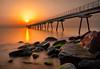 Despertar al pont (jmtostadoc) Tags: mar badalona sunrise bridge rojo piedras reflections orange pont catalunya longexposure paisaje amanecer a77 water naranja rocks red sky seascape agua largaexposición reflejos cielo