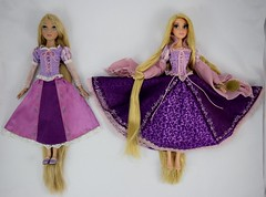 Tonner vs Disney Store LE Rapunzel Dolls - Laying Down Side by Side - Skirts Fully Extended (drj1828) Tags: tonner rapunzel 16inch doll limitededition le1000 purchase deboxed disneystore 2011 le5000 17inch sidebyside comparison review