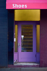 Shoes (James_D_Images) Tags: door stairs magenta awning sign white lettering shoes old building weathered stoop doorway purple blue sidewalk street