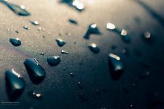 Waterdrops (Canonier82) Tags: wasser tropfen sonne pool glanz glänzen drops water sun blau gelb blue yellow