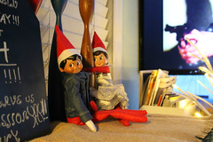 Brody & Lucy (Flint Foto Factory) Tags: ft fort myers florida urban city winter december 2017 christmas holiday vacation lucy brody elf ona shelf living room kwanzaa candles home big screen television tv show dolls toys gun
