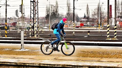 Cycling boy at train station 🚲