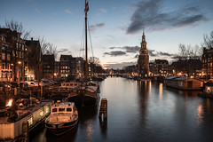 Friendly Fire (McQuaide Photography) Tags: amsterdam noordholland northholland netherlands nederland holland dutch europe sony a7rii ilce7rm2 alpha mirrorless 1635mm sonyzeiss zeiss variotessar fullframe mcquaidephotography lightroom adobe photoshop tripod manfrotto stad city urban waterside lowlight bluehour dusk twilight architecture outdoor outside building longexposure capitalcity houses house huizen huis boat houseboat woonboot fire vuur oudeschans canal gracht unesco tower montelbaanstoren canalsofamsterdam cityscape sky water reflection