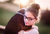 (Rebecca812) Tags: girl dog bostonterrier pet love portrait hug sunset eyeglasses lensflare sweet child people headandshoulders trust care enjoyment outdoors