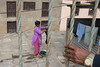 Watching the Washing Woman (Jeff Williams 03) Tags: woman washing laundry hand watcher nepal baktapur streetphoto street documentary life