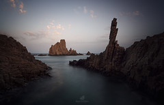 The Sea Wolf (MANUELup) Tags: almería andalucía cabodegata spain coast coastline sea seascape seashore seaside water waterscape rocks sky lassirenas gata blue orange red purple sunset summer clouds cliff longexposure sundown white