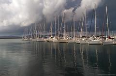 La flota de l'Alguer (Cjasar) Tags: alguer alghero flota fleet flotta sailboat barcheavela porto port harbour sardigna sardegna sardinia sea mar mare clouds nuvole winter inverno sky cielo rain pioggia