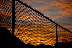 Fencing in the Sunset (donjuanmon) Tags: donjuanmon nikon fencedfriday fence sky sunset silhouette