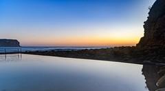 Sunrise Seascape with Sea Pool (Merrillie) Tags: daybreak sunrise macmastersbeach nature water reflections newsouthwales sea earlymorning nsw rocks ocean seascape morning centralcoast coastal seapool sky waterscape landscape coast dawn australia