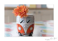 Happy New Year (hehaden) Tags: mug pottery vw volkswagen flower chrysanthemum orange table tablecloth
