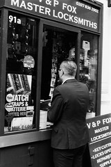Locksmith (sam.naylor) Tags: foma fomapan film 35mm 50mm lens pentax mv1 london monochrome black white city street slr contrast winter walk