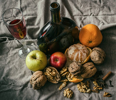 """still life (""""Life in the square"""") Tags: still life food apple orange tangerine nuts glass bottle wine cinnamon spice clove composition frame classic view color colors tone tones photo photography detail light contrast fruit drink shadows october 2015 autumn marek caran nikon d5100 reflection fine smell sweet atmosphere christmas while relax relaxing impression moment time"""