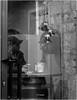 Aún es tiempo de Navidad. Still it´s Christmas Time. (Esetoscano) Tags: transparencia transparecy reflejo reflection gente people persona person campanitas bells tiempodenavidad christmastime bw bn byn monocromo monochrome soledad solitude esetoscano