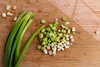 Chopped spring onions. (annick vanderschelden) Tags: chopped springonion green black vegetable scallion greenonion saladonion allium food cooking raw salads salsas recipe wooden chopping choppingboard belgium