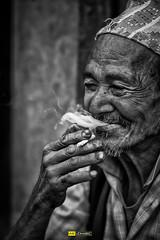Smoking Gun (Udhabkc) Tags: ifttt udhabkc udhab 500px portrait street black white nikon man smiling face monochrome smoke kathmandu nepal male beard stubble candid leader mustache elder bhaktapur facial hair bagmati zone photowalkersnp iamudhabkc