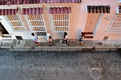 Four Across (Pedestrian Photographer) Tags: four people walking sidewalk from above cartagena street tourists tourism travelers 4 family awnings bars windows cobblestone streets walk july 2017 colombia hat phone ribbet