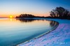 Sunrise (E. Aguedo) Tags: sunrise water beach trees snow blue hour sun colors rocky point park warwick new england winter reflection