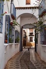 Street in Cordoba (Jocelyn777) Tags: streets cobblestones arch buildings houses whitehouses whitetowns historictowns andalucia cordoba spain travel