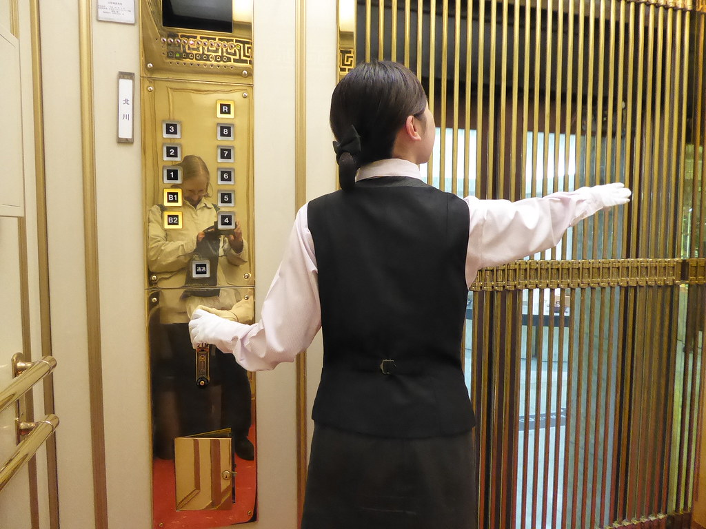 Image result for elevator attendant